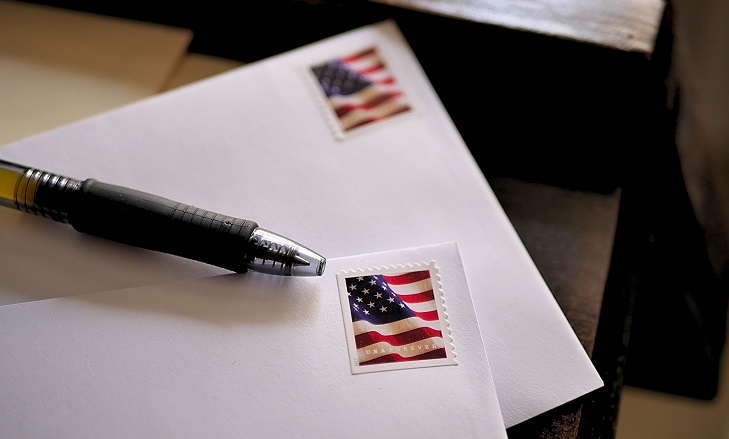 American,flag,stamps,on,letters,ready,to,be,mailed